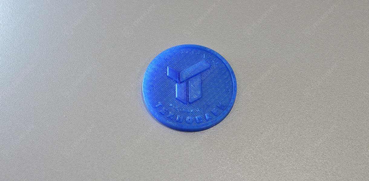 Брендированная монетка. Материал: пластик
